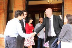 WSX Enterprise Chief Executive Peter Grant, second from right, greets guests arriving for Tea on the Lawn.